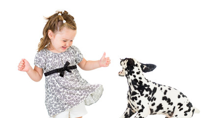 child girl playing with dog