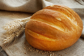 Fresh bread and ears of wheat