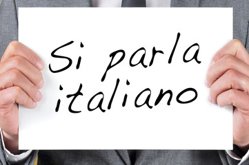 si parla italiano, we speak italian, written in italian