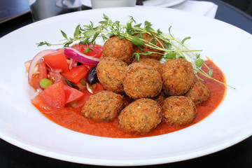 Falafel With Tomato Sauce & Cucumber Salad.