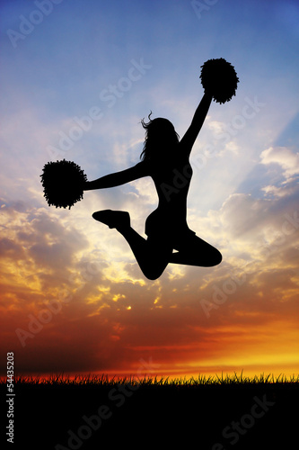 Cheerleader at sunset