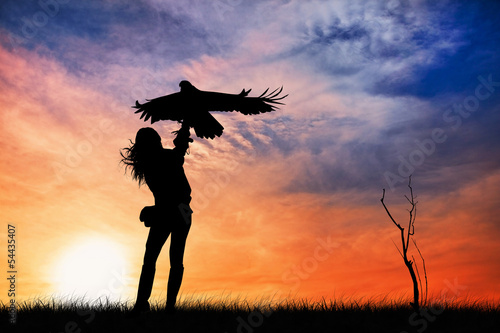 Falconer at sunset