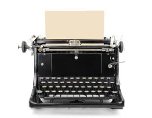 Typewriter with blank sheet isolated on white.
