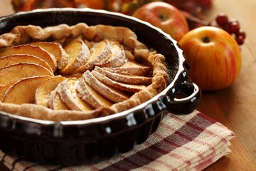 Arrangement of home-made apple pie and apples