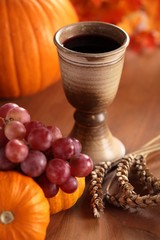 Chalice with wine, grapes, corn and pumpkins