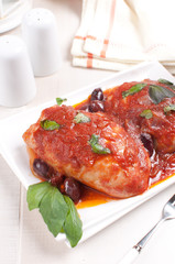 Braised chicken thighs with tomato sauce
