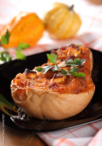 Butternut squash stuffed with minced meat, couscous and cheese.