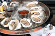 Oysters served raw with sauces - 54437203