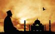 man prays in front of the Taj Mahal