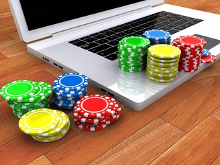 Laptop and casino chips on keyboard