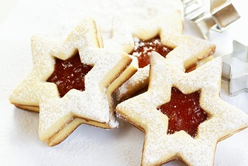Christmas cookies and cookie cutters on white background.