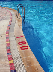 Swimming Pool with Metal Ladder and Warning