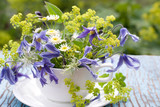 Bouquet of clematis and alchemilla