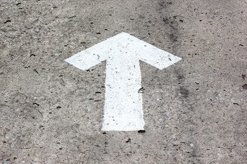 white arrow sign on road