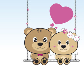 Wedding bears sitting on a swing