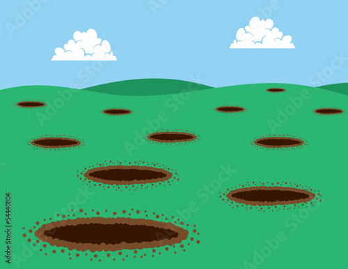 Multiple holes in grassy field