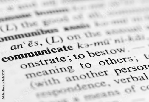 Close up of communicate definition