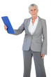 Businesswoman holding her clipboard and looking at camera