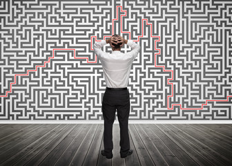 Confused businessman looking at a maze