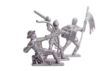 Fighting toy soldiers on a white background, knights