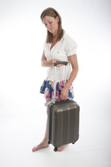 Woman with wheel along cabin bag