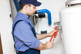 Plumber repairing a hot-water heater
