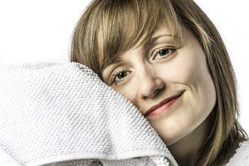 Young girl snuggled in towel