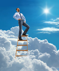 Laughing confident businessman high in the sky