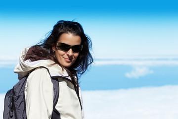 Cute Young Woman in High Mountain Range