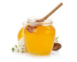 glass jar full of honey and stick - 54450089