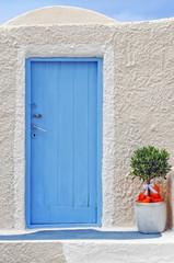 Blue traditional door in Oia