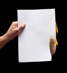 Man hand holding white burned paper