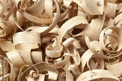 Wooden shavings in workshop on planks