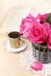 Beautiful pink roses in vase on wooden table close-up