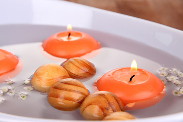 Beautiful candles swim in beautiful plate