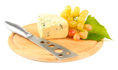 Tasty blue cheese and grape on cutting board, isolated on white