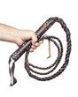 male hand holding brown leather whip isolated on white backgroun