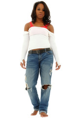 Beautiful black woman in torn jeans and white shirt standing on