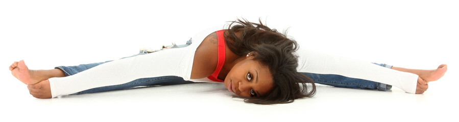 Beautiful black woman doing a split on white floor. Clipping pat