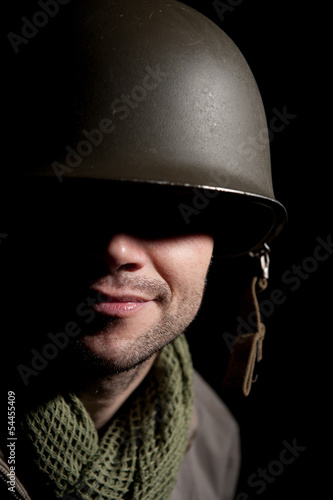 WW2 American Soldier With Face In Shadow