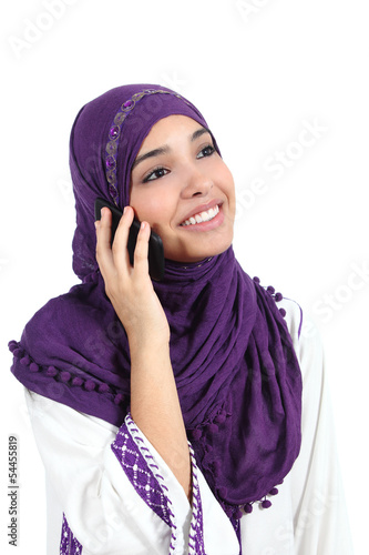 Beautiful muslim woman talking on the mobile phone