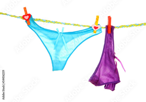 Women's panties hanging on rope isolated on white