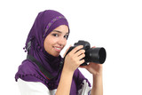 Arab woman wearing a hijab taking a photography poster