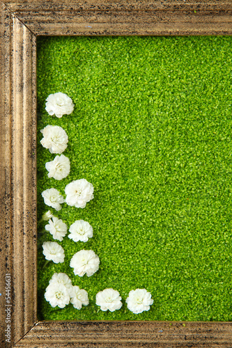 Picture of colored decorative sand with flowers close-up