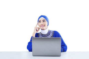 Beautiful muslim thinking with laptop - isolated