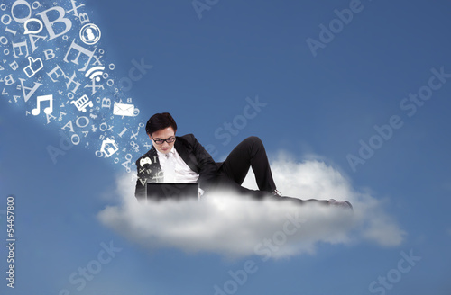 Asian businessman working on cloud with flying alphabet