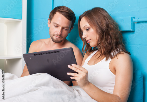 Young couple browsing internet on tablet computer