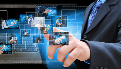 businessman hand pushing a button streaming images on a touch sc
