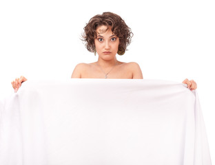 Astonished girl clothed a white sheet on a white background