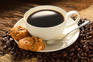 Coffee cup with cookies and fresh coffee beans © amenic181